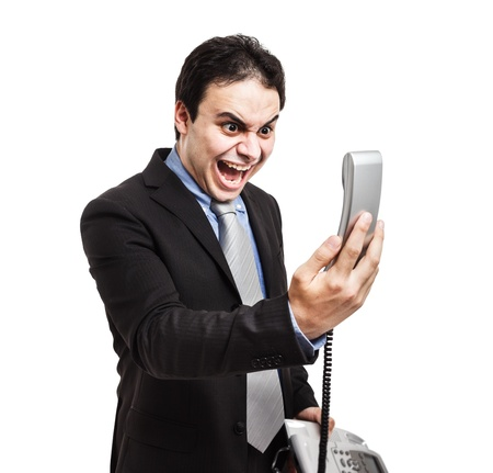 man screaming: Portrait of an angry businessman yelling at phone