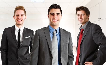 males only: Happy businesspeople in their office Stock Photo