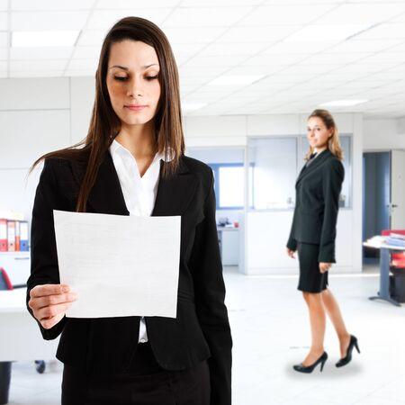 finance report: Businesswoman reading a business document