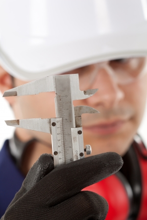 Worker looking at his caliper photo