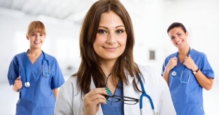 Portrait of a beautiful doctor holding eyeglasses Stock Photo - 15287961