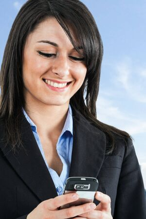 Portrait of a beautiful woman using a cell phone Stock Photo - 15288076