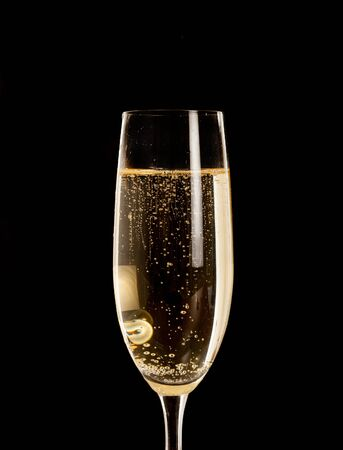 champagne glass: Champagne flute isolated on black Stock Photo