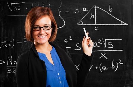 algebra: Portrait of a smiling beautiful math teacher Stock Photo