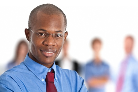 african businessman: Portrait of a businessman in front of his team Stock Photo
