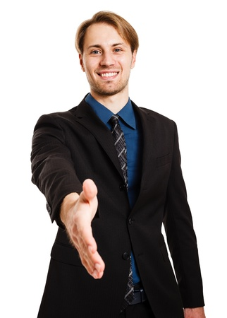 Portrait of an handsome businessman giving an handshake Stock Photo - 15444444
