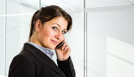 Portrait of a beautiful businesswoman talking on the phone Stock Photo - 15444669