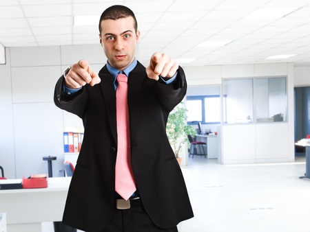 Businessman pointing his finger at you photo