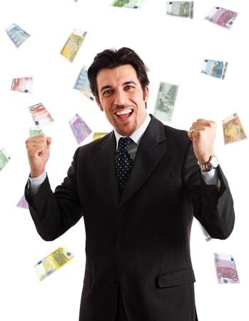 millonario: Hombre feliz disfrutando de una lluvia de dinero Foto de archivo