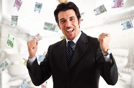 Happy man enjoying a rain of money Stock Photo - 15444918