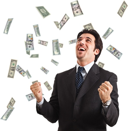 Happy man enjoying the rain of money photo