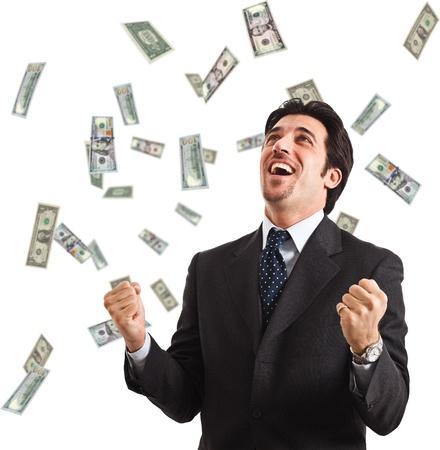 hombre cayendose: Hombre feliz disfrutando de la lluvia de dinero Foto de archivo
