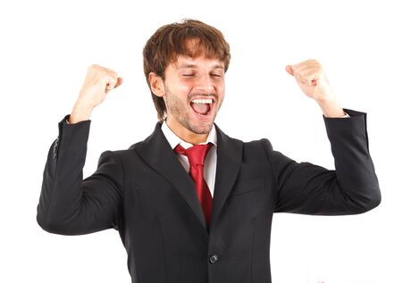 succesful: Portrait of an handsome businessman raising arms in sign of victory