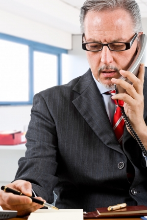 Portrait of a senior businessman at work Stock Photo - 15444814