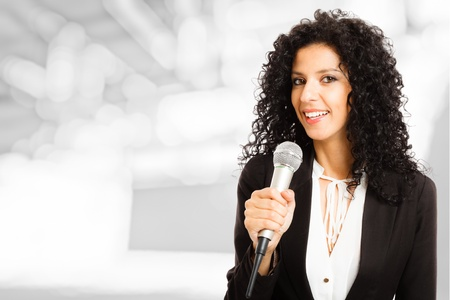 journalist: Portrait of a beautiful woman speaking in a microphone Stock Photo