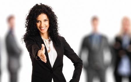 Portrait of a beautiful businesswoman offering an handshake