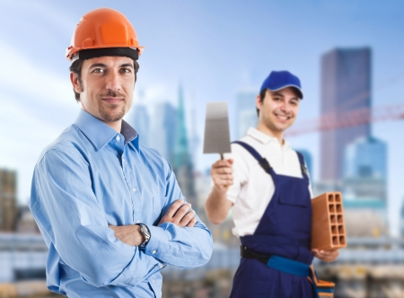 Portrait of a site manager and a bricklayer Stock Photo - 15667931
