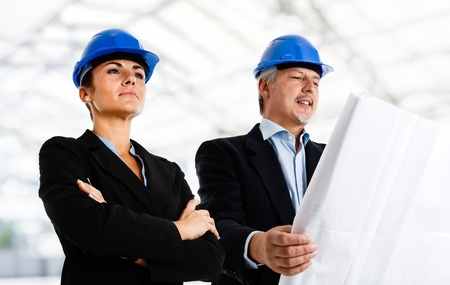 service engineer: Engineers at work in a construction site