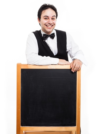 Portrait of a professionale waiter showing an empty blackboard photo