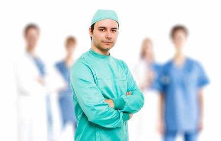 Surgeon in front of his team photo