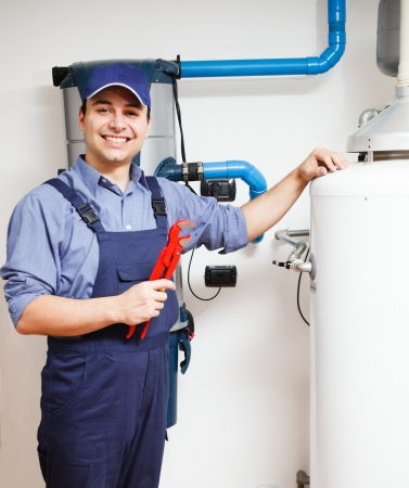 craftsperson: Portrait of a smiling plumber at work