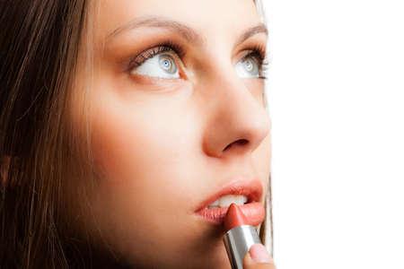 lip stick: Portrait of a beautiful woman applying the lipstick