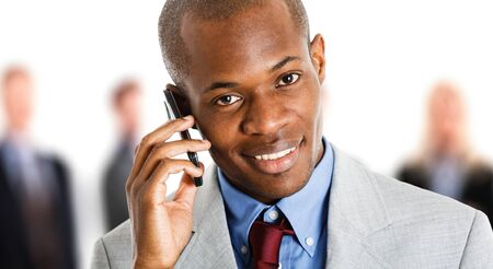 Portrait of a smiling businessman talking on the phone photo