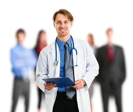 pacientes: Retrato de un apuesto m�dico frente a sus pacientes Foto de archivo