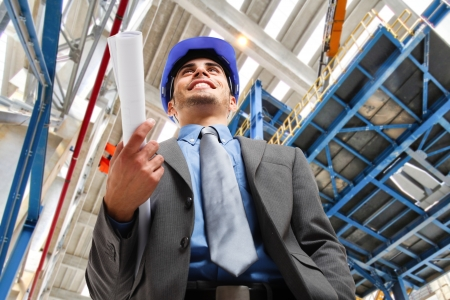 Portrait of a smiling engineer holding a blueprint Stock Photo - 15672464