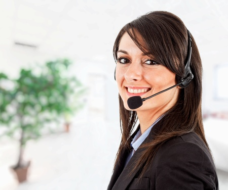contact center: Portrait of a beautiful girl with headset Stock Photo