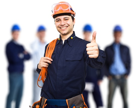 Portrait of an happy worker in front of his team Stock Photo
