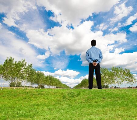 environmental concept: Businessman looking at a beautiful landscape Stock Photo