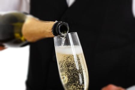 pour: Portrait of a waiter pouring champagne into a flute