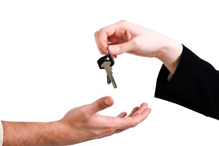 Hand passing a set of keys to another hand Stock Photo - 15965980