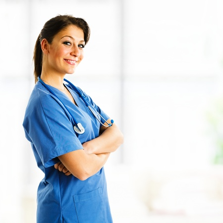 sexy female doctor: Portrait of a beautiful smiling nurse