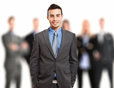 successful leadership: Portrait of a smiling businessman in front of his team Stock Photo