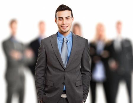 gerente: Retrato de un hombre de negocios sonriente en frente de su equipo Foto de archivo