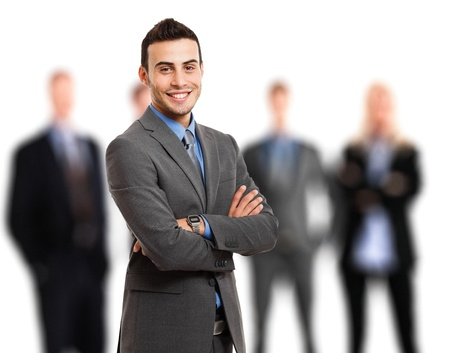 business leader: Portrait of a smiling businessman in front of his team Stock Photo