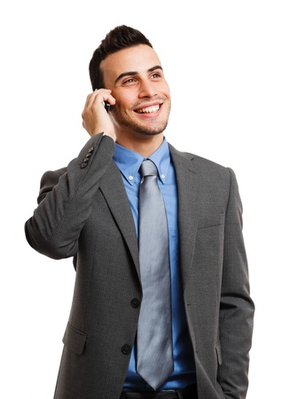 businessman talking: Portrait of a young businessman talking on the phone