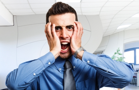 frantic: Portrait of a screaming businessman Stock Photo