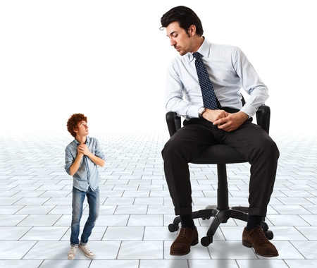 against: Small young man frightened by a big businessman