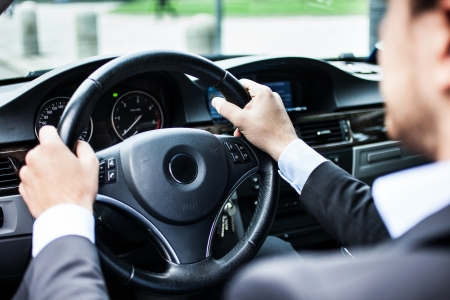 auto leasing: Portrait of a man driving his car Stock Photo