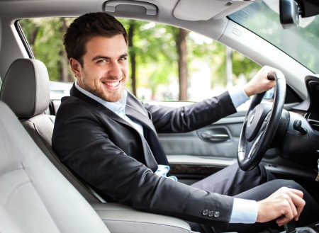 Portrait of an handsome man driving his car Stock Photo - 16129512