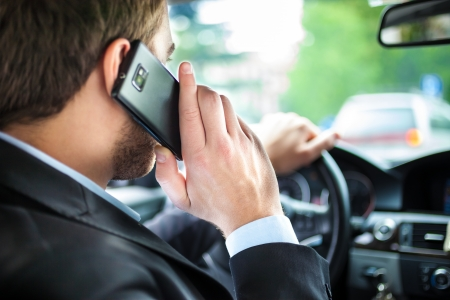 parking ticket: Man talking on the phone on his car Stock Photo