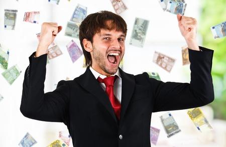 good fortune: Happy man enjoying a rain of money Stock Photo