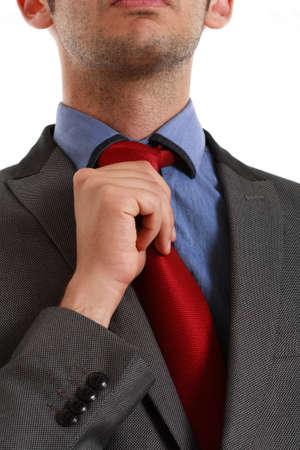 adjust: Detail of a businessman adjusting his tie