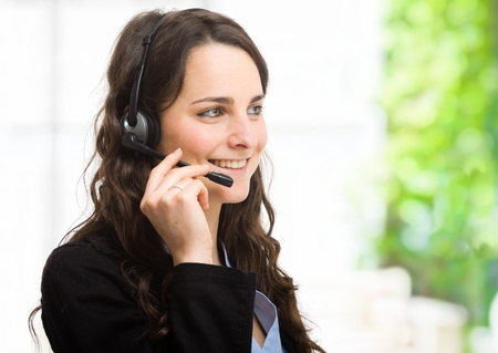 Portrait of a beautiful customer representative Stock Photo - 16129515