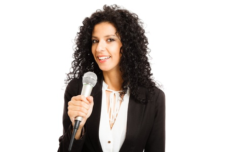 newsreader: Portrait of a beautiful woman speaking in a microphone Stock Photo