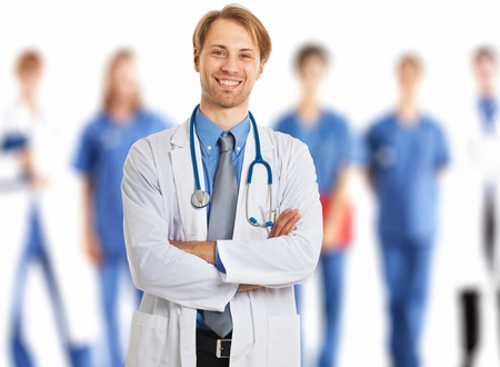Confident doctor in front of his medical team photo