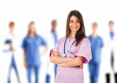 Portrait of a nurse in front of her medical team photo
